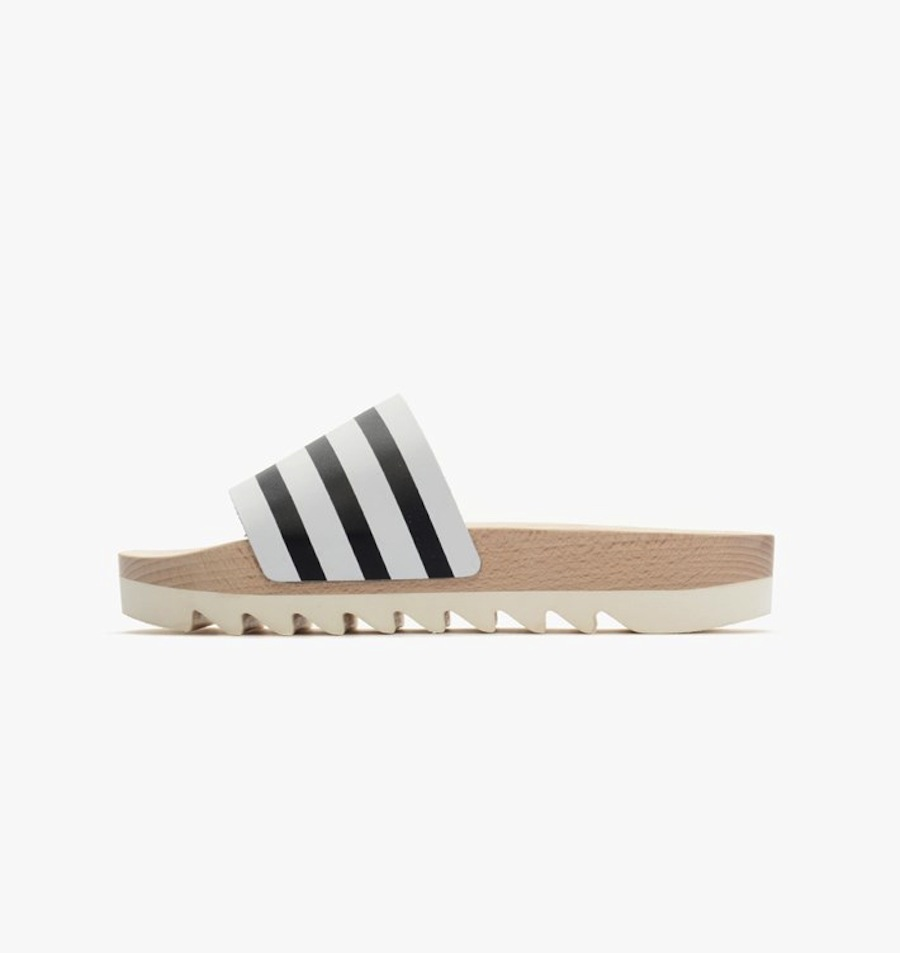 Adidas has gone high fashun, released a wooden version of the Adilette slide