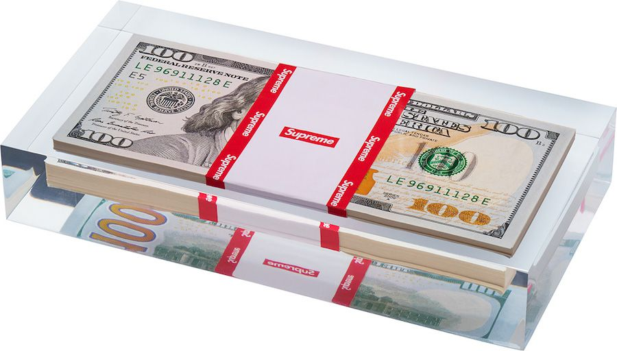 Supreme's FW collection features a paperweight containing real 100 dollar bills