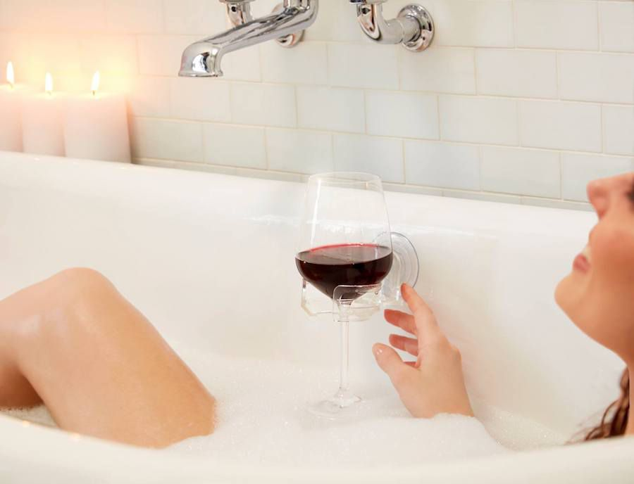 Someone invented a wine cupholder for your bath
