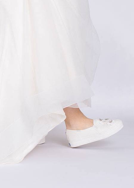 Kate Spade and Keds have released a collection of bridal sneakers